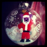 """The Dingo Starring as Santa"" acrylic hand painted glass ornament"