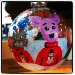 """The Dingo Starring as Dog in a Christmas Sweater"" acrylic hand painted on a glass ornament"